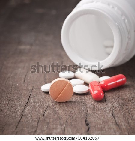 Medical pill on wooden table.Close up photo - stock photo