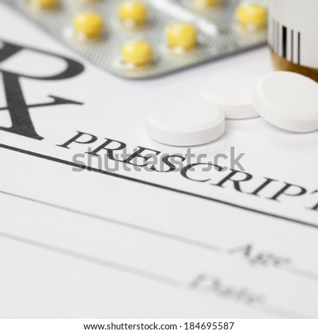 Medical prescription and several pills on table - 1 to 1 ratio - stock photo