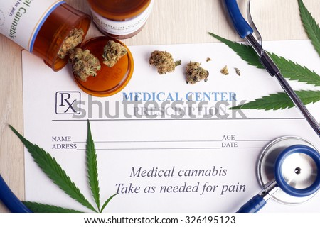 Medical prescription with dry cannabis on table close up - stock photo