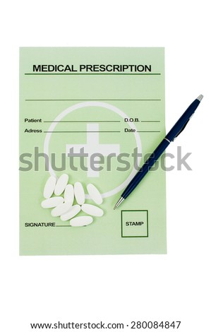 Medical prescription with pills and a pen on it. Pharmacy concept isolated on white table - stock photo