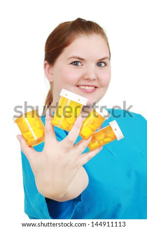Medical professional with pills - stock photo