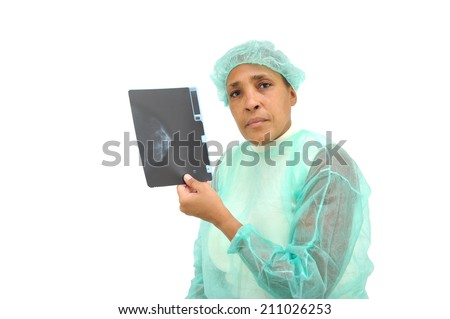 Medical Professional Woman looking at camera Wearing Hospital Gown and Cap holding Breast Exam X-ray isolated on white background - stock photo