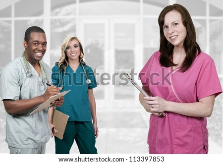 Medical professionals standing in front of an office or hospital - stock photo