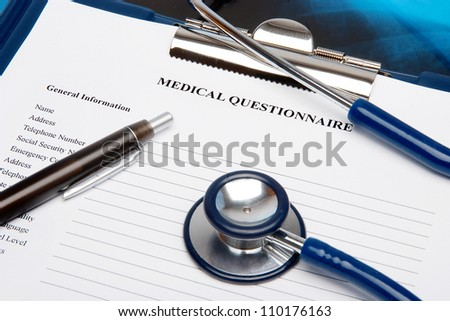 Medical questionnaire in a clipboard with a stethoscope - stock photo