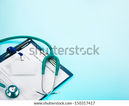 Medical questionnaire, stethoscope and empty ID tag on blue background  - stock photo