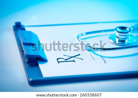 Medical questionnaire, stethoscope on blue background. Empty medical prescription - stock photo