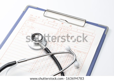 Medical record and Stethoscope on white background - stock photo
