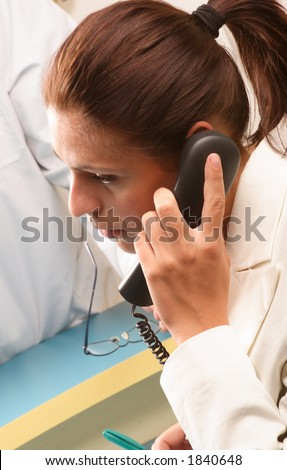 Medical secretary on the phone - stock photo