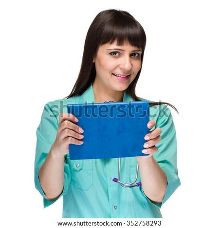 Medical sign. Young woman doctor or nurse showing empty blank clipboard sign with copy space for text. Caucasian female model isolated over white background. - stock photo