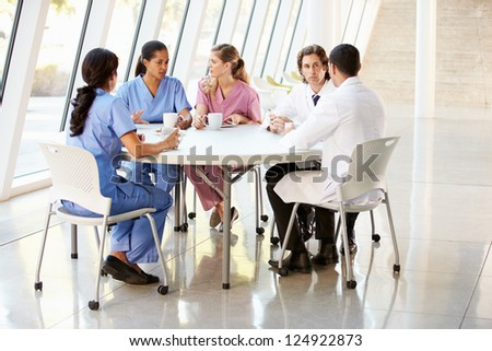 Medical Staff Chatting In Modern Hospital Canteen - stock photo