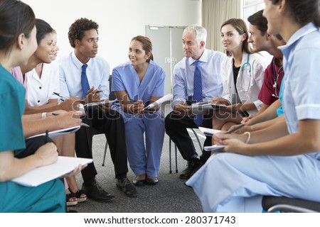 Medical Staff Seated In Circle At Case Meeting - stock photo