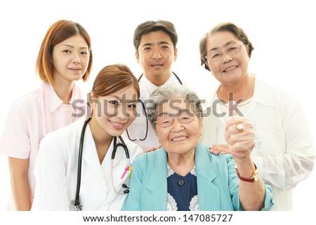 Medical staff with senior women - stock photo