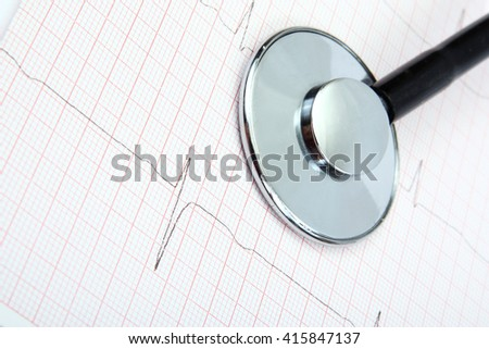 Medical stethoscope, ekg, electrocardiogram on white background.  - stock photo