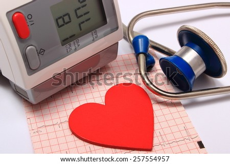 Medical stethoscope, instrument for measuring blood pressure and red heart shape with electrocardiogram graph, ekg heart rhythm, medicine concept - stock photo