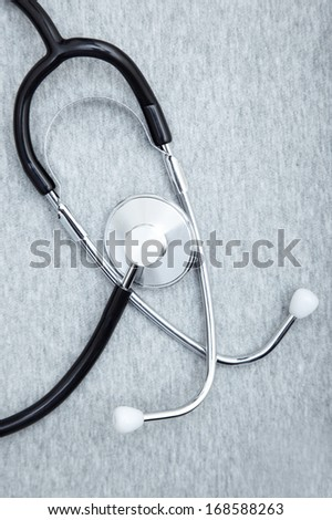 Medical stethoscope on a textured background. Close-up photo - stock photo