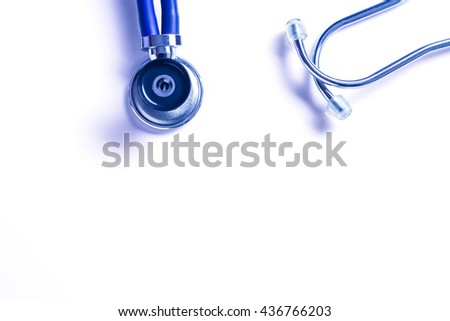 Medical stethoscope on blue background. Medicine, health hospital equipment for health care, treatment. Closeup diagnostic instrument, examination device for pulse, heartbeat.Cardiology test. - stock photo
