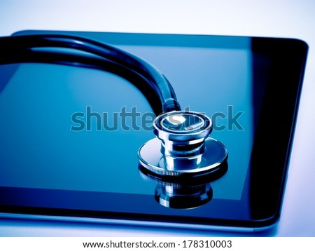 medical stethoscope on modern digital tablet in laboratory. Concept of health care with new technology - stock photo