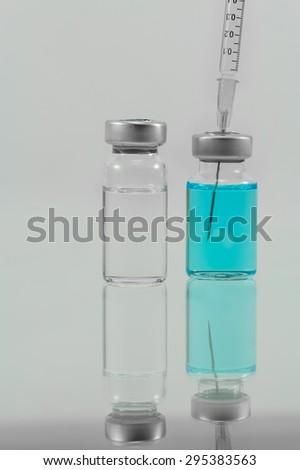 medical syringe and medicine  isolated on white background - stock photo