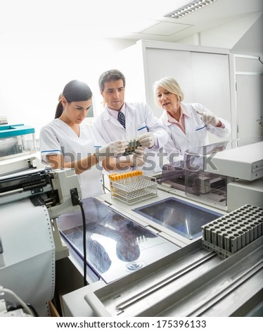 Medical team analyzing samples in laboratory - stock photo
