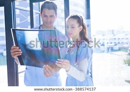 Medical team examining x-ray at the hospital - stock photo