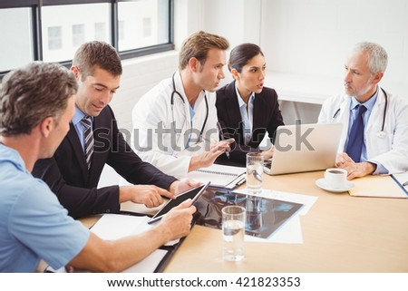Medical team having a meeting in conference room in hospital - stock photo