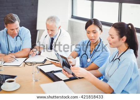 Medical team interacting at a meeting in conference room - stock photo