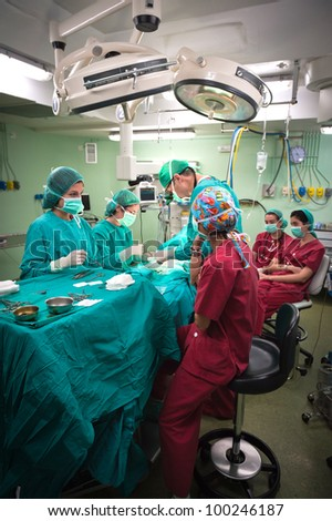 Medical team performing surgery at the hospital - stock photo