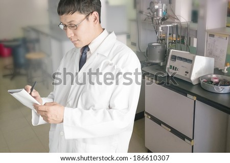 Medical technologist in the laboratory. - stock photo
