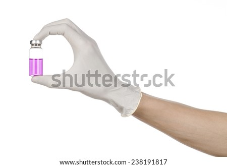 Medical theme: doctor's hand in a white glove holding a purple vial of liquid for injection isolated on white background  - stock photo