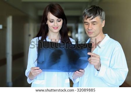 Medical theme: doctors are studying x-ray. - stock photo