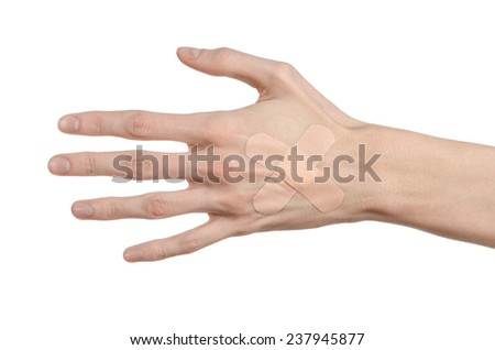 Medical theme: for a man's hand glued medical plaster first aid plaster advertising on a white background - stock photo