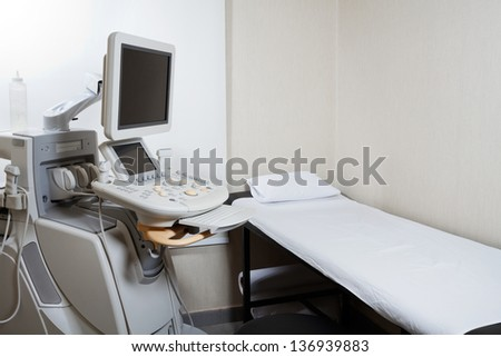 Medical ultrasound diagnostic equipment at clinic - stock photo