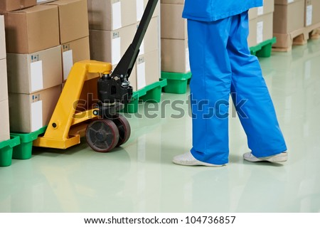 medical warehouse works by lifting stacking equipment and boxes with medcine drugs stack arrangement - stock photo
