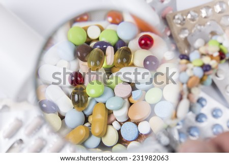 Medicaments under magnifying glass - stock photo