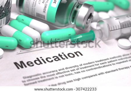 Medication. Concept with Composition of Medicaments - Light Green Pills, Injections and Syringe. Blurred Background with Selective Focus. - stock photo