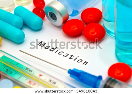 Medication - diagnosis written on a white piece of paper. Syringe and vaccine with drugs. - stock photo