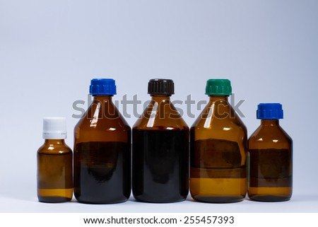 Medication in different glass bottles on white background. - stock photo