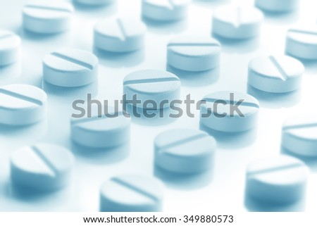 Medication Pills White Background. Pills in a row. Green Blue. - stock photo