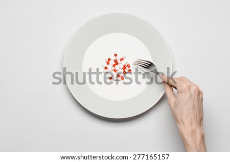 Medications and improper nutrition topic: human hand hold a plate with pills isolated on white background top view - stock photo
