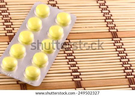 Medicinal pills piled up a bunch of closeup - stock photo