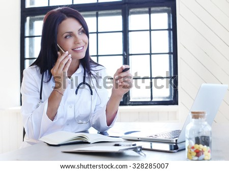 Medicine. Beautiful doctor in the hospital - stock photo