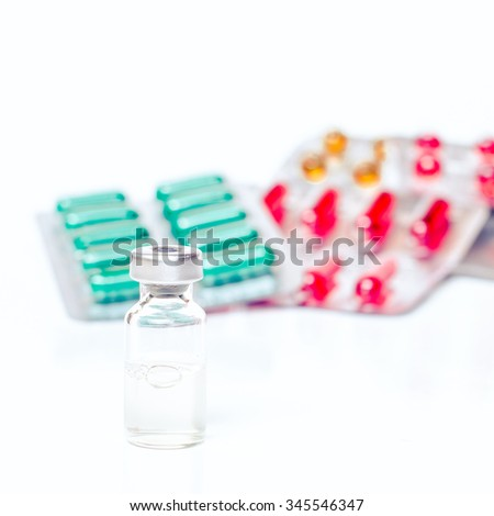 Medicine bottle for injection and pills. Medical glass vial for vaccination. Science equipment, liquid drug or vaccine from treatment, flu in laboratory, hospital or pharmacy. Orange, yellow, red - stock photo