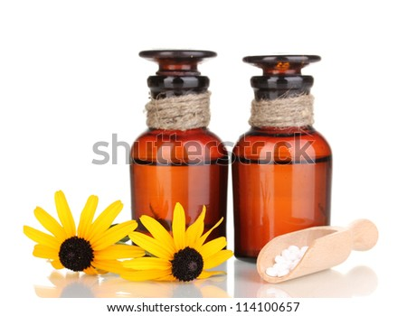 medicine bottles with tablets and flowers isolated on white - stock photo