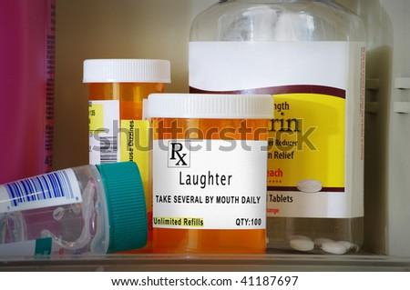Medicine cabinet with prescription bottles and a prescription of laughter - stock photo