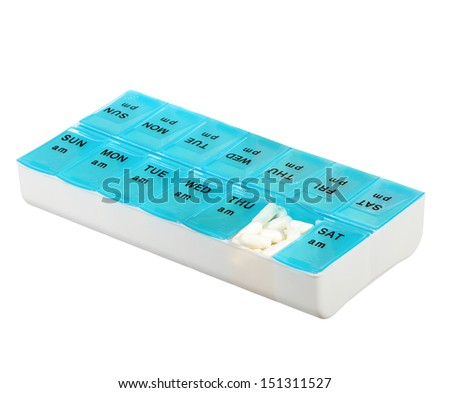Medicine dose box isolated on white background. Weekly dosage of medication in blue pill dispenser - stock photo