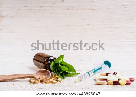 Medicine herb. Herbal pills, syringe, injection with healthy medical plant. Green leaf, alternative drug. Natural pharmaceutical capsule. Vitamin supplement for care, medication - stock photo