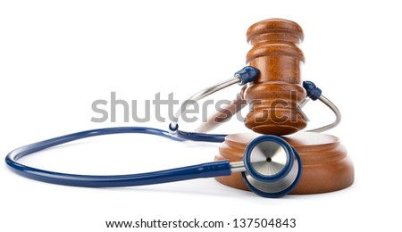 Medicine law concept gavel and stethoscope isolated on white background - stock photo