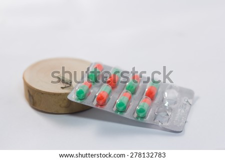 medicine on wood and The insects lay dead beside - stock photo
