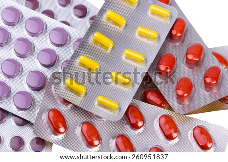 Medicine pills and capsules packed in blisters isolated on white background - stock photo