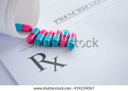 medicine pills on prescription form - stock photo